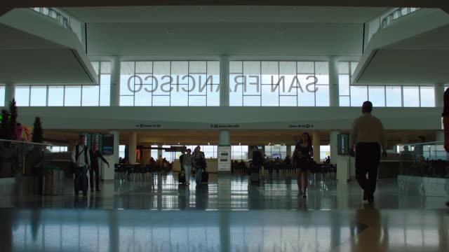 ms td people walking at gate in sfo - san francisco international airport stock videos & royalty-free footage