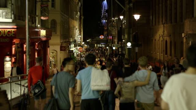 People walking at night in London