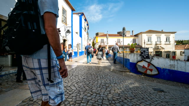 t/l people walking at obidos old town, portugal - lisbon stock videos and b-roll footage