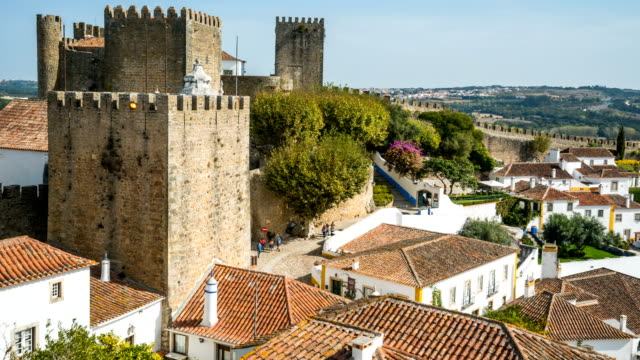 t/l people walking at obidos old town, portugal - leiria district stock videos & royalty-free footage