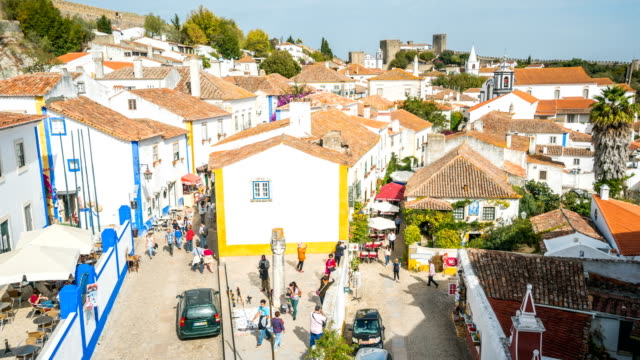 T/L People walking at Obidos old town, Portugal