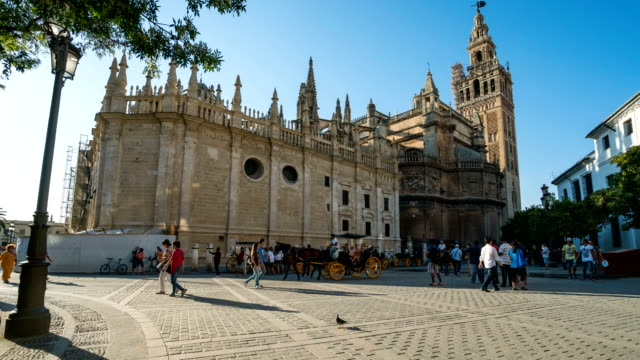 T/L People walking at Seville Cathedral, Spain