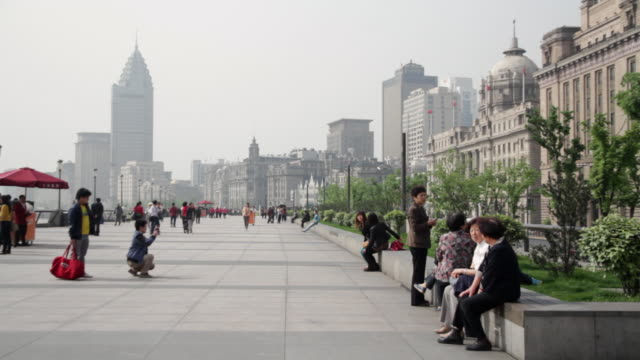 ms people walking at shanghai bund near buildings / shanghai, china - the bund stock videos & royalty-free footage