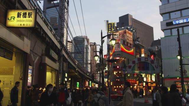 WS People walking at Shinbashi station at dusk / Tokyo, Tokyo-To, Japan