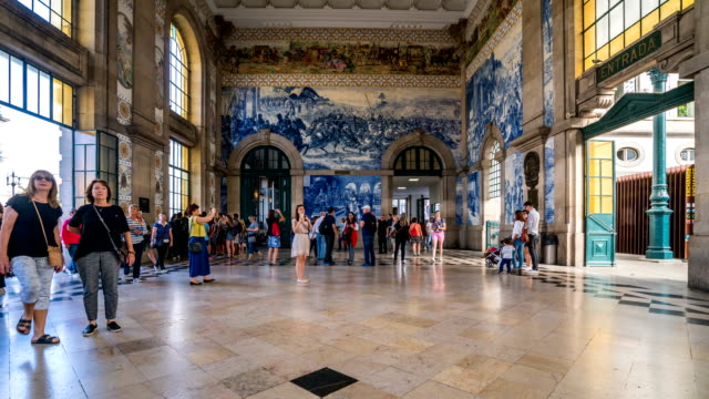 t/l people walking at the sao bento railway station, porto, portugal - portugal stock videos & royalty-free footage