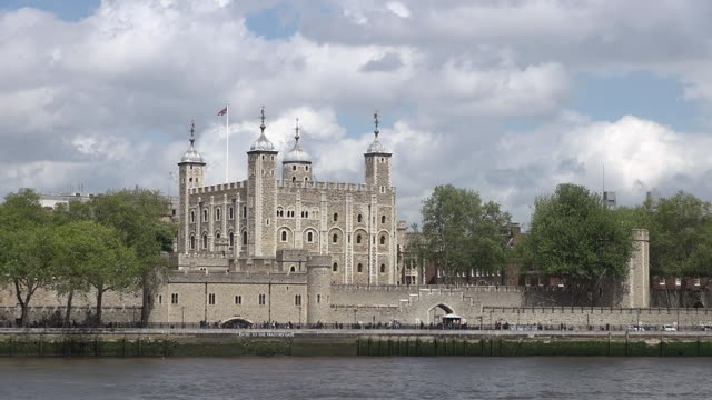 ws people walking at tower of london in front of thames river / london, united kingdom - tower of london stock videos and b-roll footage
