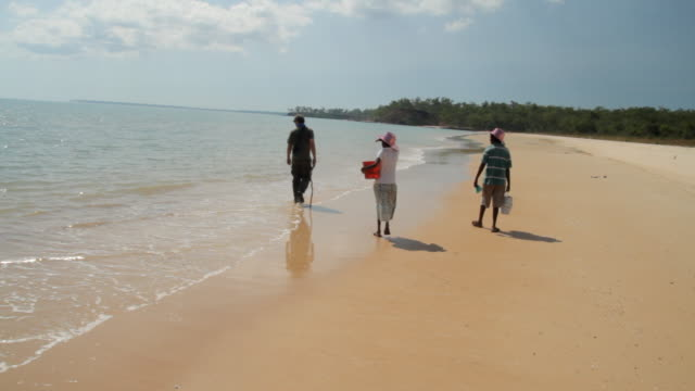 ms pan people walking away on beach on tiwi islands / northern territory, australia - tiwi people stock videos & royalty-free footage