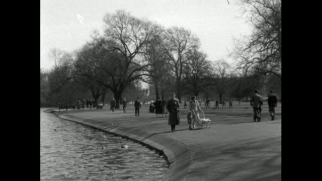 people walking beside a lake in regent's park; 1956 - lakeshore stock videos & royalty-free footage