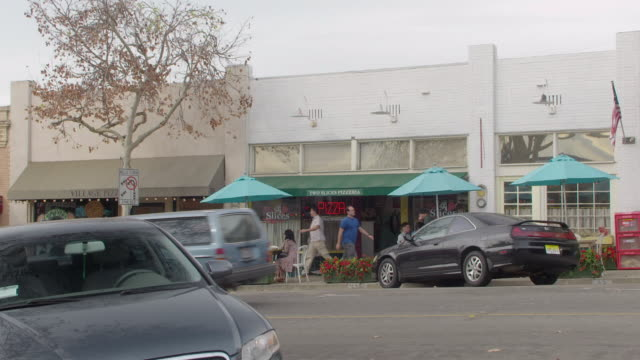 ms people walking by store fronts / sierra madre, california, united states - sierra madre stock-videos und b-roll-filmmaterial