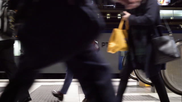 people walking by train and escalators - underground train stock videos & royalty-free footage