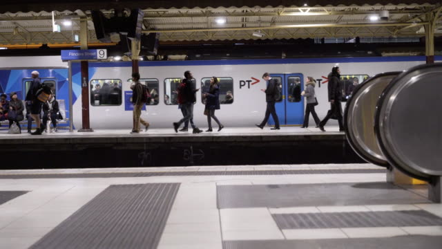 people walking by underground railway platform - train vehicle stock videos & royalty-free footage