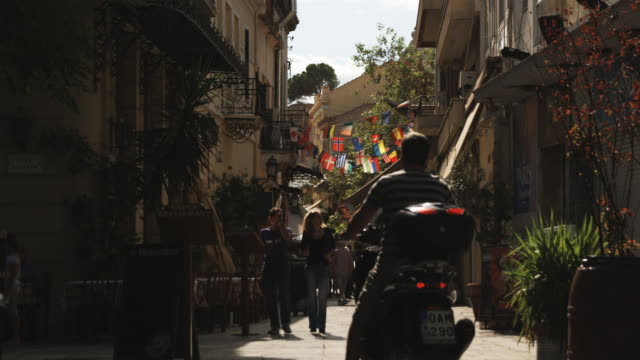 people walking down a european street - athens greece stock videos & royalty-free footage
