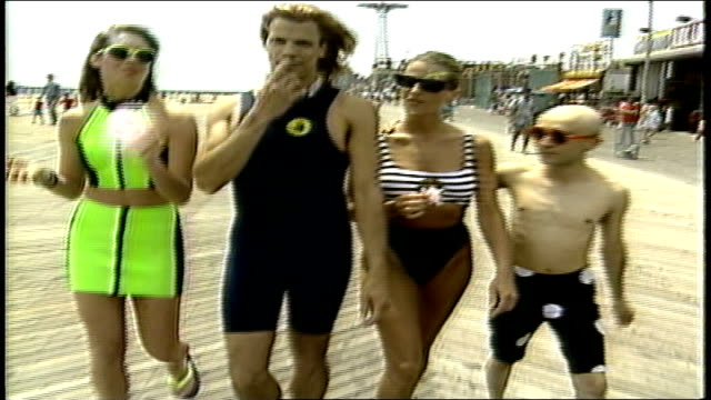 people walking down boardwalk at coney island - hairstyle stock videos & royalty-free footage