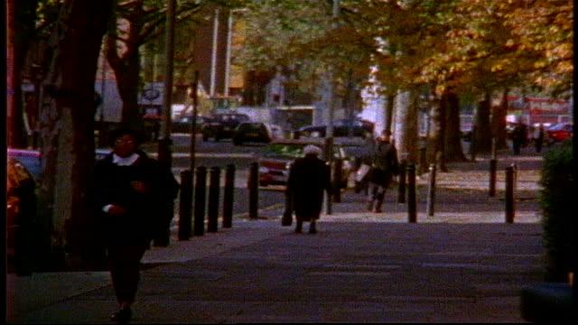 people walking down london sidewalk on super 8 film - grainy stock videos & royalty-free footage