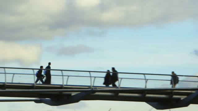 SLO MO POV MS People walking down Millennium Bridge / London, England, United Kingdom