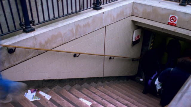 t/l, ha, cu, people walking down stairs into underground station, london, england - steps and staircases stock videos & royalty-free footage