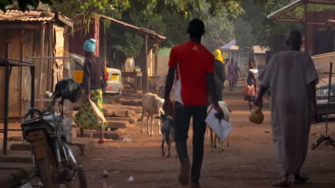 people walking down the street in ghana - africa stock videos & royalty-free footage