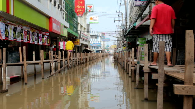 people walking during the monsoon flooding in thailand - monsoon stock videos & royalty-free footage