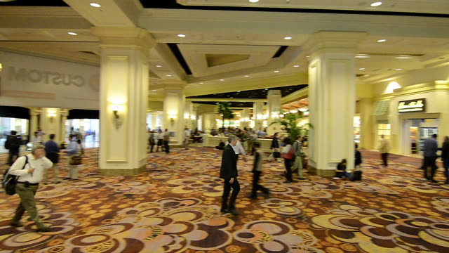 ws pan people walking in a convention hall - lobby stock videos & royalty-free footage