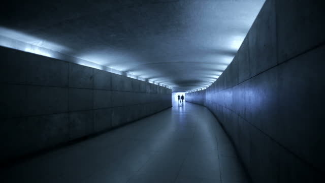 people walking in a underground tunnel in paris, france - tunnel stock videos & royalty-free footage