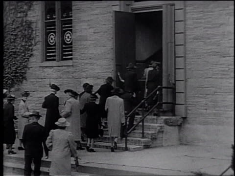 1945 montage people walking in and attending church service / united states - frank capra video stock e b–roll
