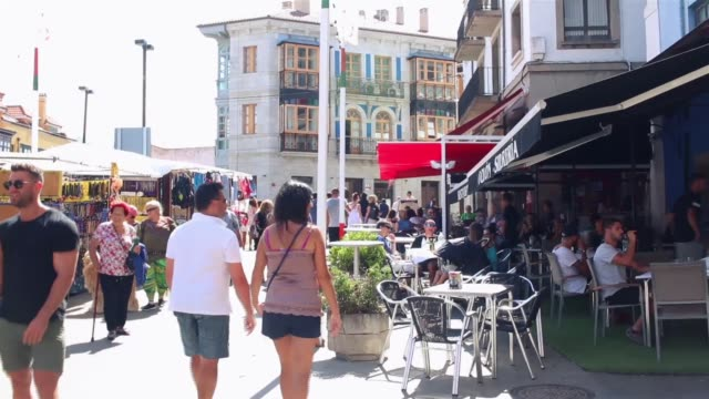 People walking in central Llanes (port area)