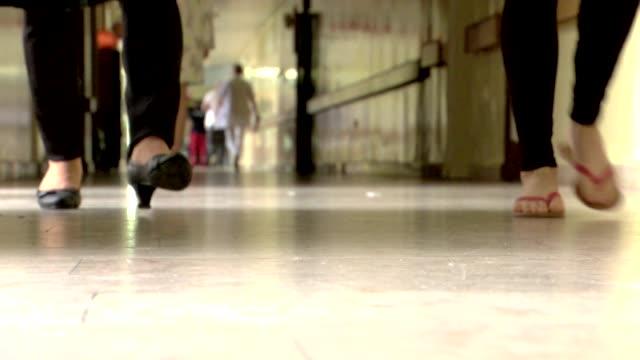 people walking in corridor - corridor stock videos & royalty-free footage