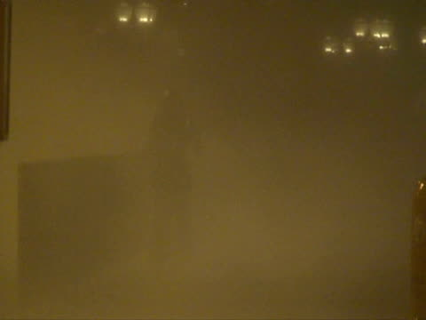 people walking in extreme wind rain, typhoon koppu, hong kong on night of 14th sept 2009. with audio. - microburst stock videos & royalty-free footage