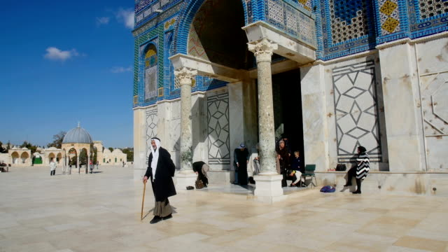 People walking in front of Dome of the Rock/ Jerusalem old city
