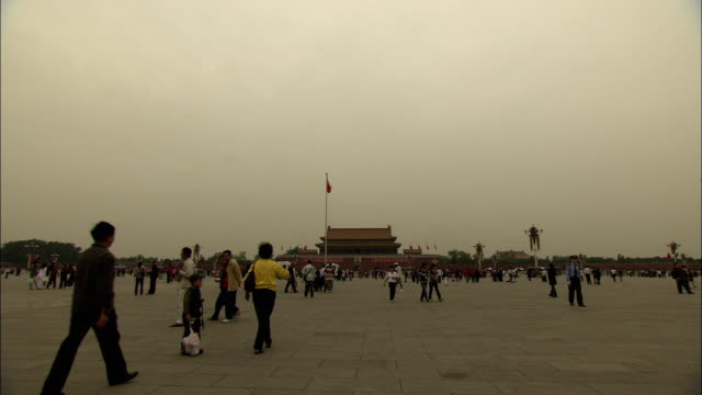 ws people walking in front of gate of heavenly peace in tiananmen square, beijing, china - tiananmen gate of heavenly peace stock videos & royalty-free footage