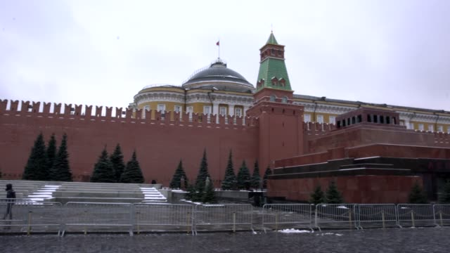 people walking in front of lenin's mausoleum in red square, moscow, russia - red square stock videos & royalty-free footage