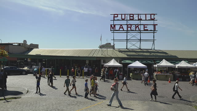 t/l people walking in front of pike place market / seattle, washington, usa - pike place market stock videos and b-roll footage