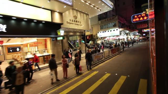 vídeos de stock, filmes e b-roll de ms pov people walking in front of shops / hong kong, china - ponto de vista de bonde