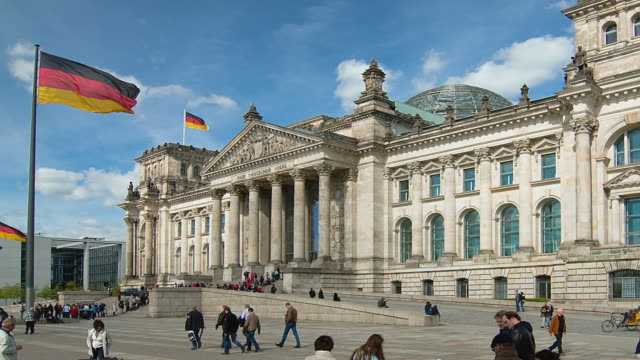 ws pan t/l people walking in front of the reichstag / berlin, germany  - german flag stock videos & royalty-free footage