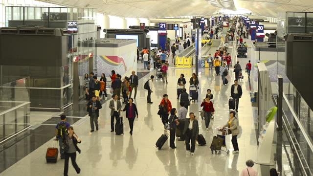 wa ha people walking in hong kong international airport - hong kong international airport stock videos and b-roll footage