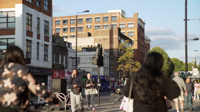 people walking in london bethnal green road - road signal stock videos & royalty-free footage