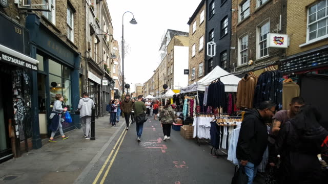 people walking in london brick lane market - point of view stock videos & royalty-free footage