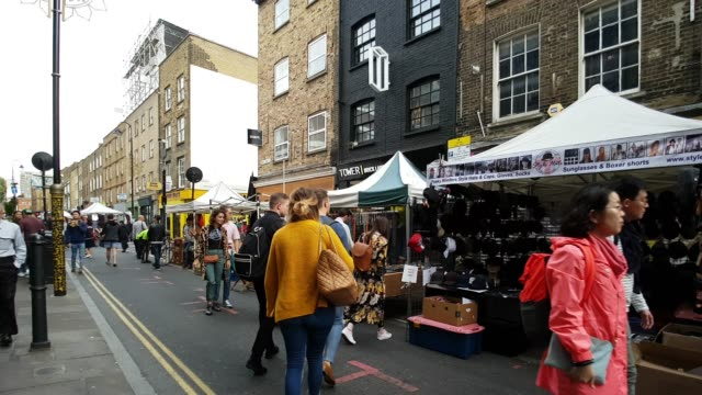 people walking in london brick lane market - market stall stock videos & royalty-free footage