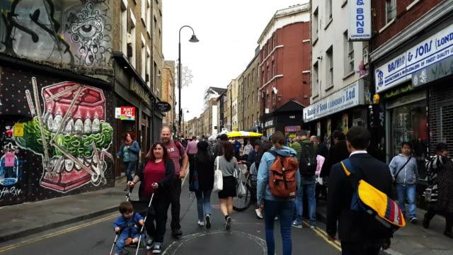 People Walking in London Brick Lane