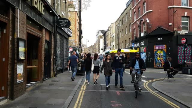 people walking in london brick lane - walking point of view stock videos & royalty-free footage