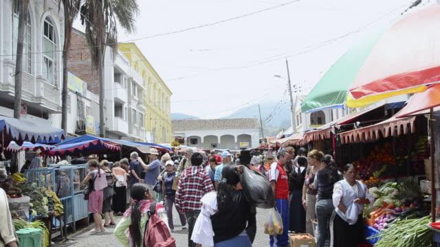 MS People walking in maket / Otavalo, Ecuador