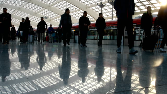 people walking in modern airport station - pavimento video stock e b–roll