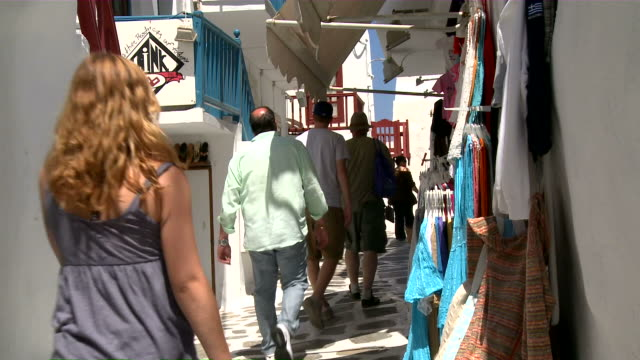 ms people walking in narrow  walkway / myconos, cylades islands, greece - mykonos stock videos and b-roll footage
