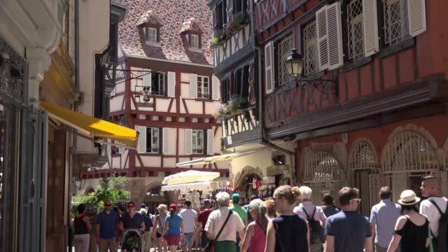People walking in old town with half-timbered houses