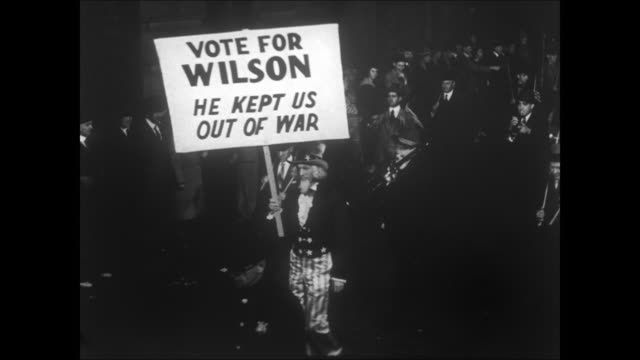 people walking in parade in night carrying signs supporting woodrow wilson - 1910 stock videos & royalty-free footage