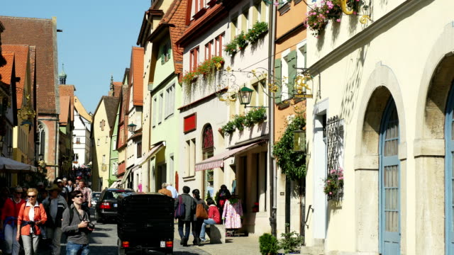 people walking in rothenburg schmiedgasse (4k/uhd to hd) - romantic road germany stock videos and b-roll footage