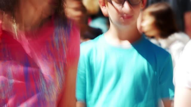 ms people walking in shopping street (4k/uhd to hd). - softfokus bildbanksvideor och videomaterial från bakom kulisserna