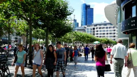 people walking in shopping street (4k/uhd to hd) - pedestrian zone stock videos & royalty-free footage