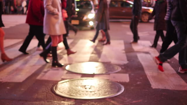 people walking in slow motion. pedestrians commuting in the city at night. new york city street scene