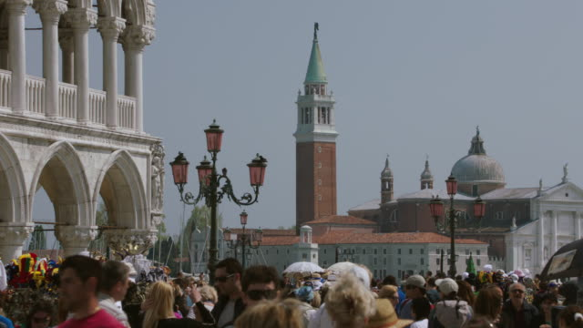 ws people walking in st mark's square, san marco campanile / venice, italy - bell tower tower stock videos and b-roll footage